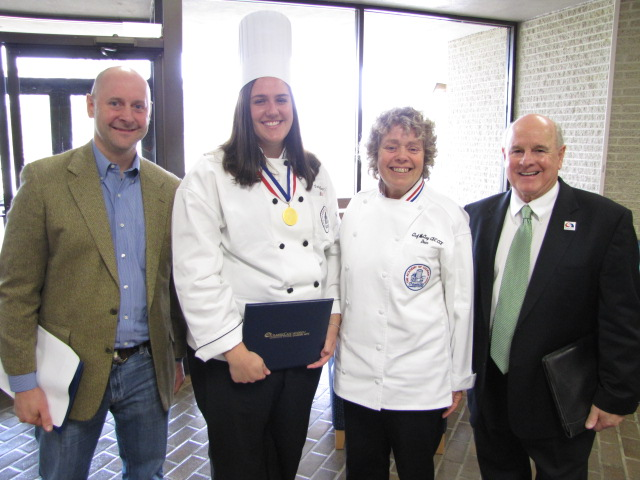 From left: Chef Terence Feury '88, executive chef/owner of Tavro Thirteen in Swedesboro and Academy of Culinary Arts alumni; Tayler Reed of Egg Harbor Township, class valedictorian; Kelly McClay, dean of the Academy of Culinary Arts; and Dr. Peter Mora, president of Atlantic Cape Community College, at the Academy of Culinary Arts Awards Ceremony at Atlantic Cape's Mays Landing Campus May 20.