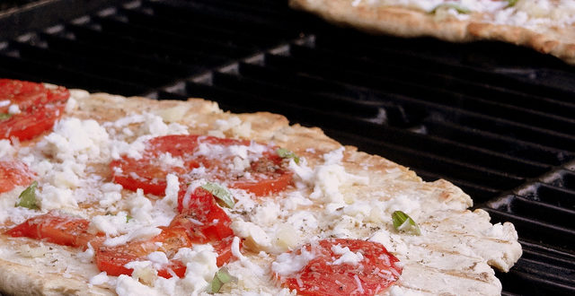 pizza grilling on grill. tomato basil pizza recipe