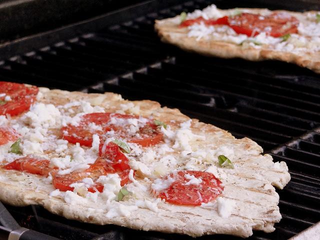 pizza grilling on grill. tomato basil pizza recipe