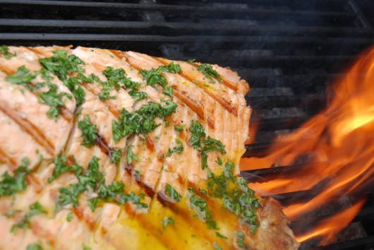 "Grilled Whole Salmon with Grilled Vegetables and Tomato Vinaigrette"" (in progress on the grill), recipe from Chef David Burke, photo credit Cheryl Larkin."