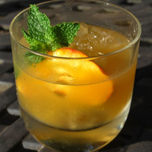 A Whiskey Peach Smash is the perfect for the Summer to Fall transition.