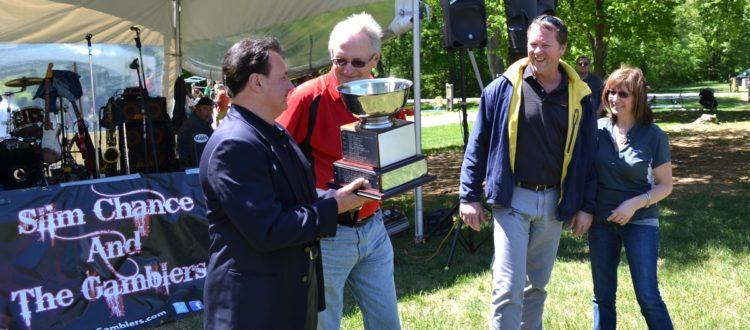 Marco Bucci, Renault's winemaker receiving the Governor's Cup Trophy for best overall wine