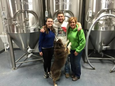 It's Bring Your Family to Work Day at Departed Soles. Brian with his mother, cousin Molly and his dog Bogan.