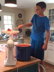 Chantale's son Giuseppe helping Mom on tomato sauce day.