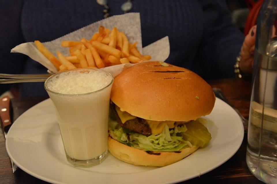 Burger with a cute vanilla milkshake