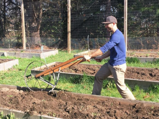 Plowing the raised beds of Fulfill's Garden