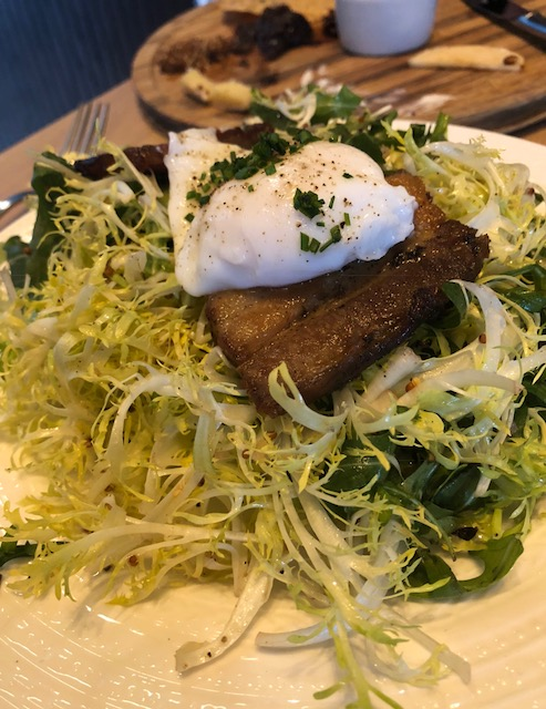 Frisée and Pork Belly Salad with a Soft Poached Egg and Mustard Vinaigrette
