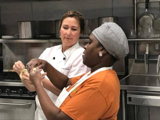 Chef Lisa with a student at Fulfill