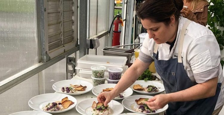 photo of Chef Meg LaManna plating dishing for a party