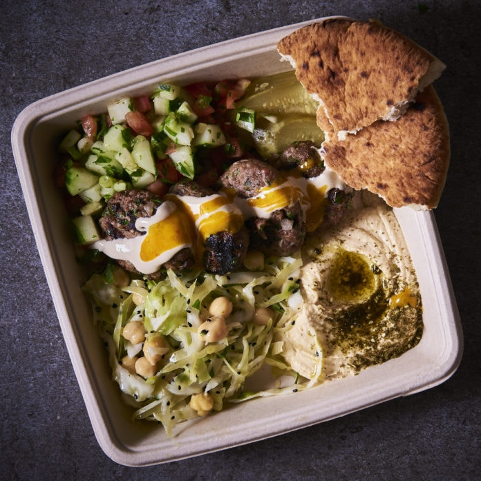 "Kuffta ""al ha plancha""platter – w/ Tahina, amba, Israeli salad and pickles and a side of hummus and Cabbage chickpea salad, mixed with, scallions, parsley, niagella seeds olive oil and lemon juice"