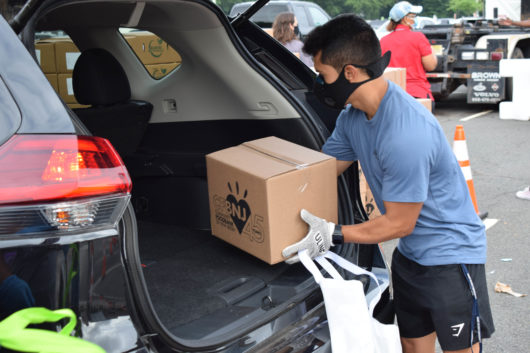 Community Foodbank of New Jersey volunteer loads car