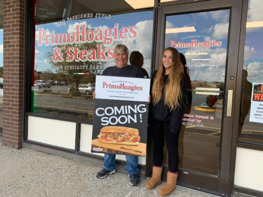 Primo Hoagies owners in front of store