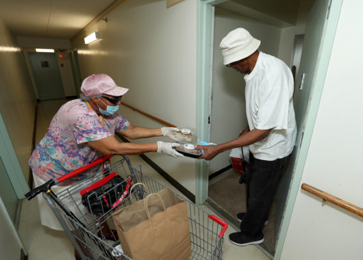 Woman delivering food from Newark Working Kitchens