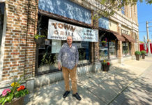 John Copeland in front of Town Grill
