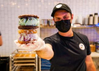 man holding ice cream sandwiches
