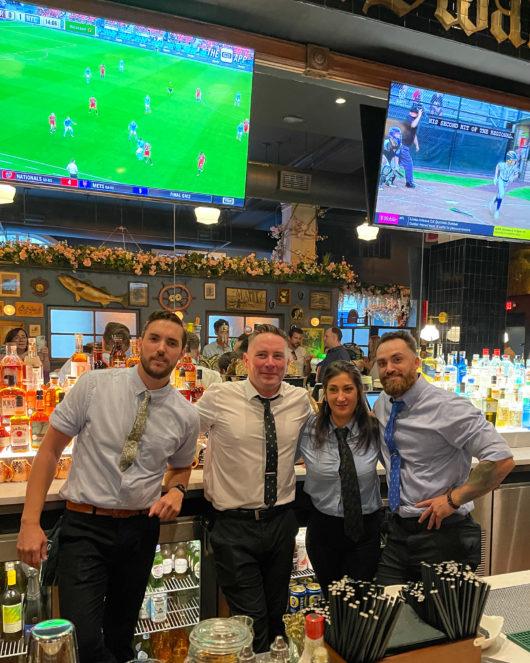 bartenders behind bar