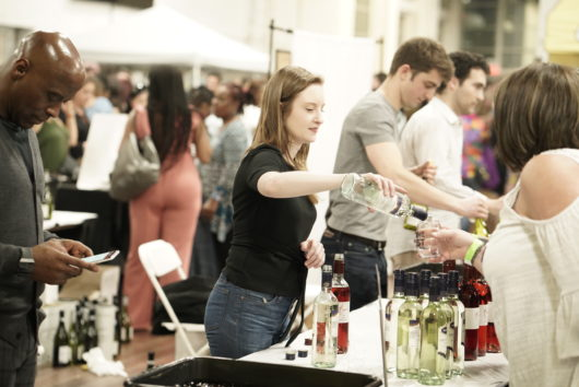 woman pouring wine at festival